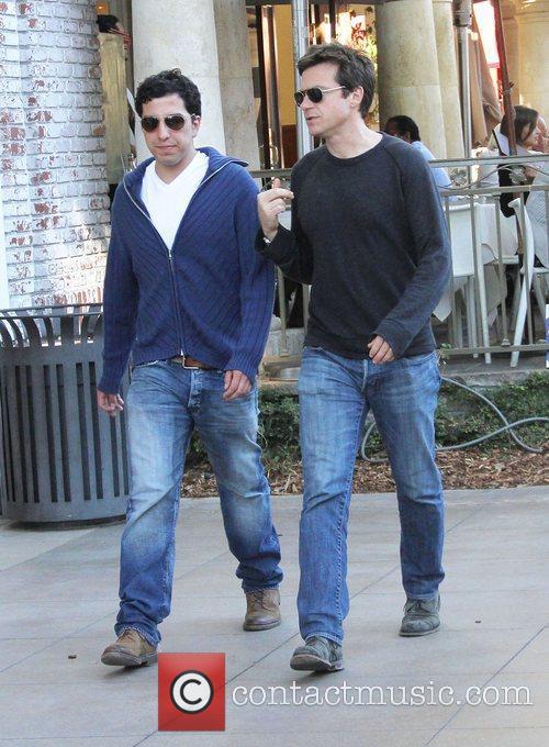 Jason Bateman and a friend are seen walking...