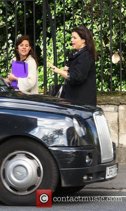 Hails a black cab after leaving Hotel GB