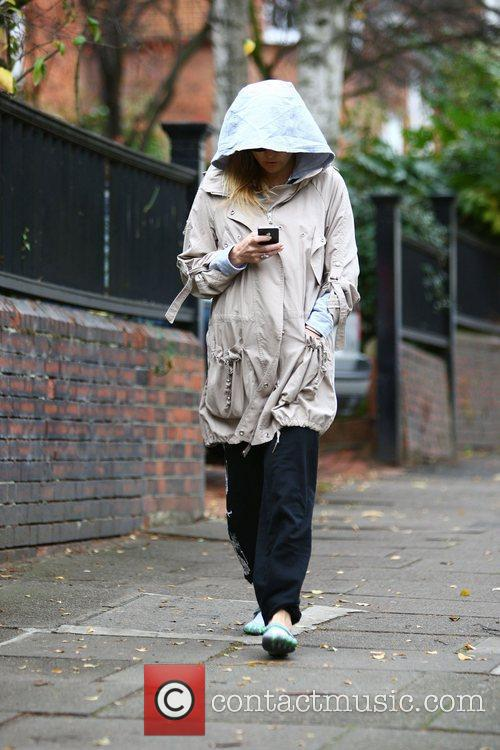 With her hood up, walking in North London