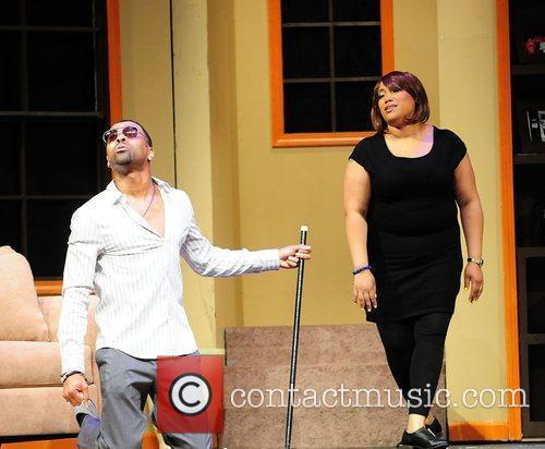 Ginuwine and Lisa Page Brook performs on stage...