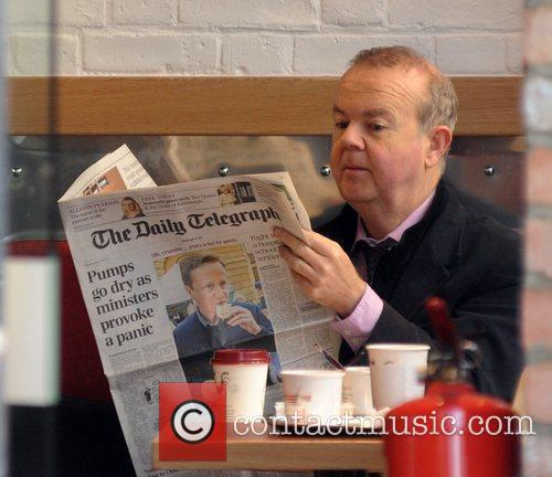 ian hislop eating breakfast and reading a 3804912
