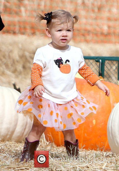 At Mr. Bones Pumpkin Patch with her parents