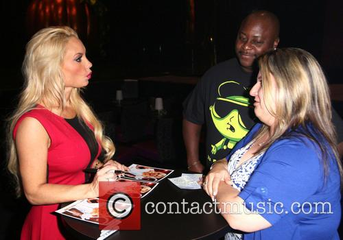 Coco; Fans Ice T and wife Coco spend...