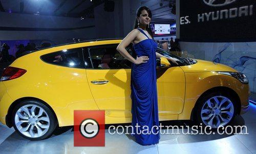 A model poses with the Hyundai Volester car...