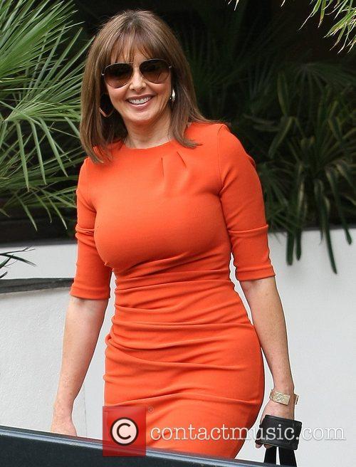 Outside the ITV studios wearing an orange dress...