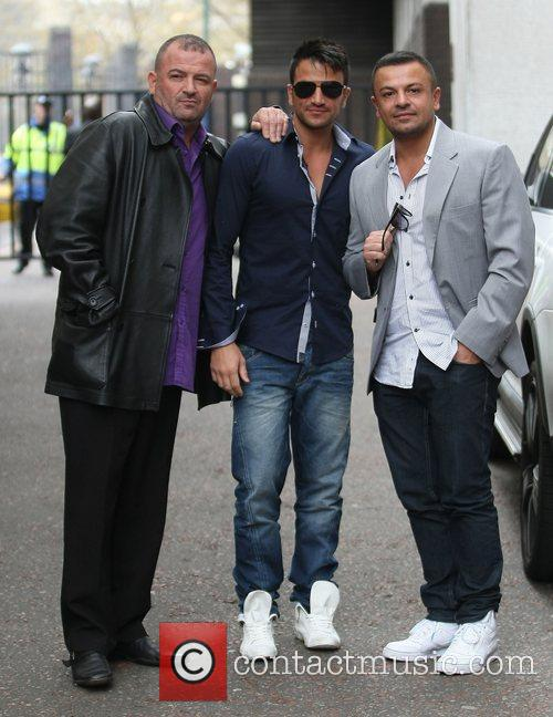 Peter Andre with his brothers Chris and Mike...