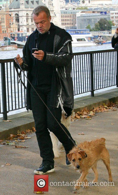 Graham Norton walking his pet dogs Bailey and...