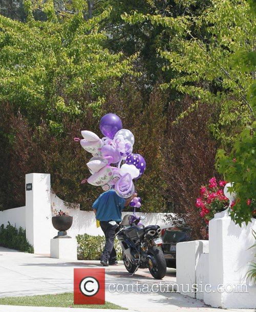 Has balloons delivered to his house to celebrate...
