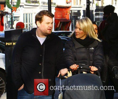 James Corden and Julia Carey walking with their...