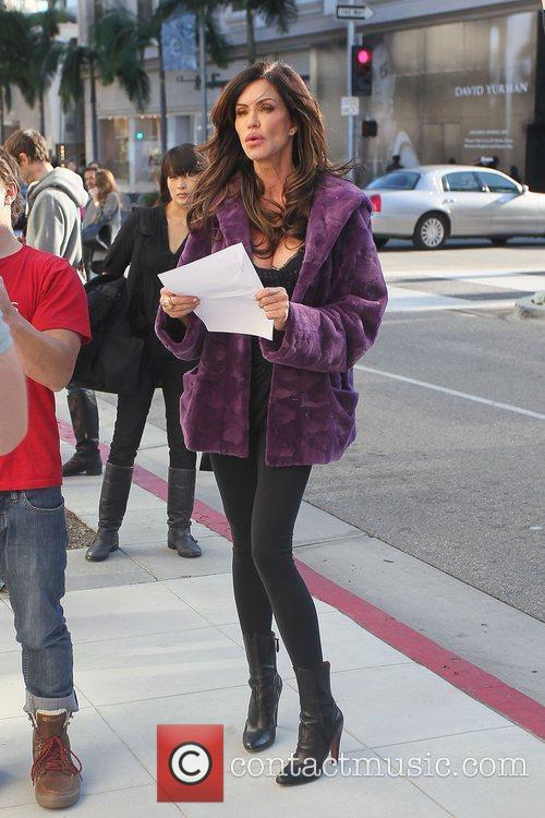 Janice Dickinson filming on Rodeo Drive wearing a...
