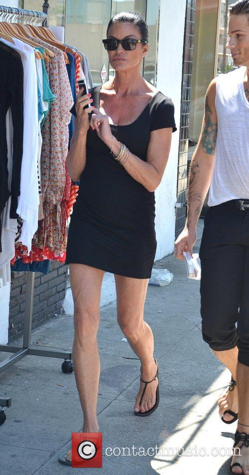 Walks through a sunny West Hollywood with a...