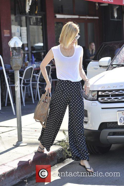 January Jones is seen leaving a children's boutique...