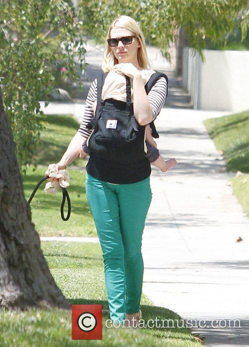 January Jones walks her dog whilst carrying her...