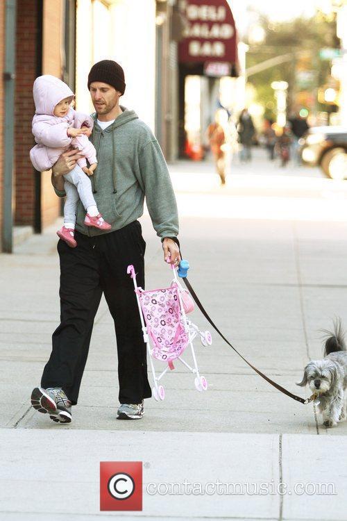 Take their dog for a walk in Manhattan