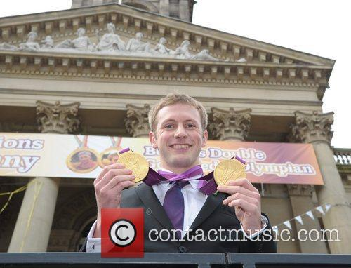 Olympic gold medal cyclist Jason Kenny is given...
