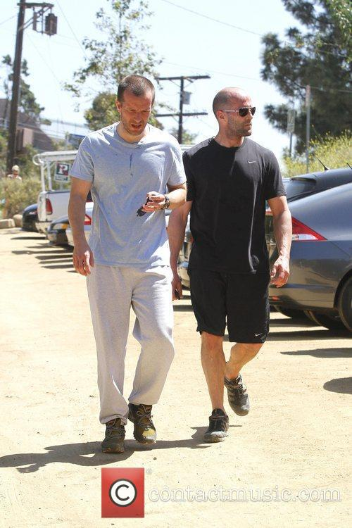 Jason Statham and a friend are seen taking...