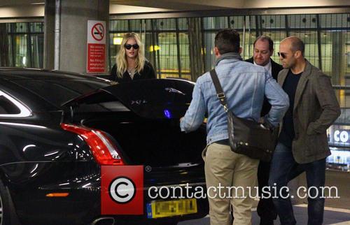 Jason Statham, Rosie Huntington-Whiteley and Heathrow Airport. Their 1