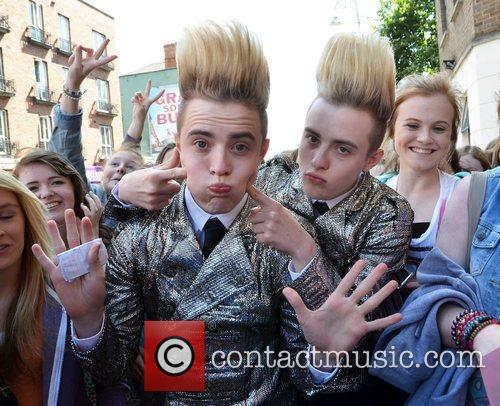 Jedward get mobbed by their female fans outside...