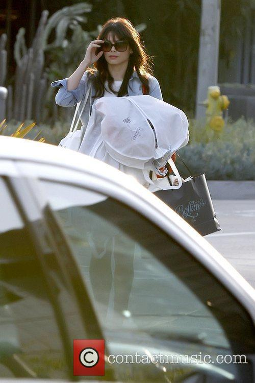 Has her hands full as she goes shopping...