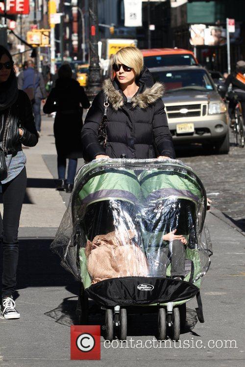 Pushing her stroller through SoHo