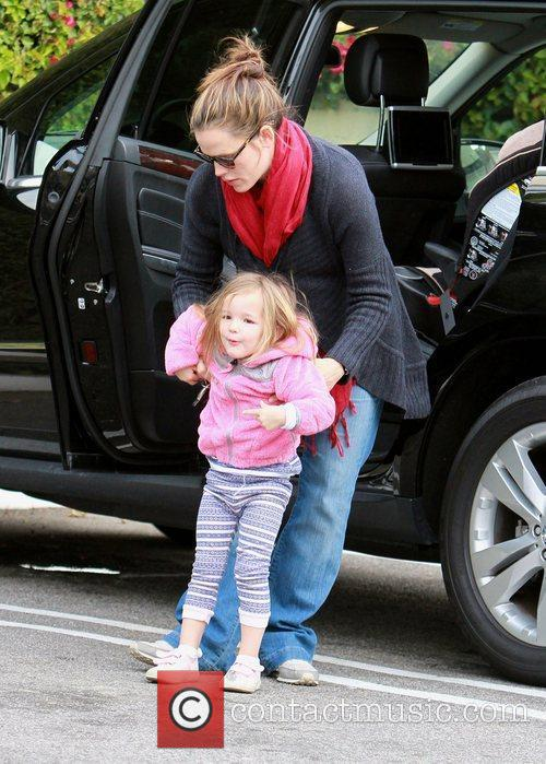 Jennifer Garner and her daughter Seraphina Affleck walking...