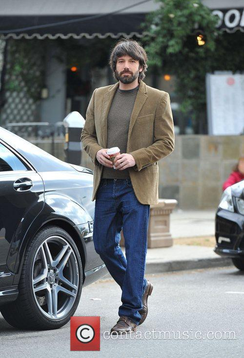Ben Affleck exits a toy store while looking...