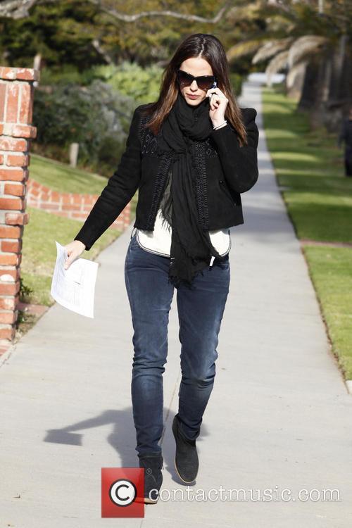 Jennifer Garner seen on her cell phone while...