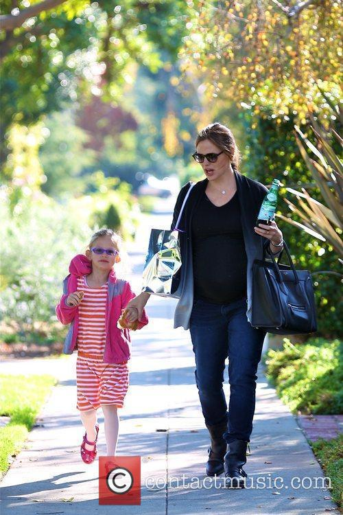 An expectant Jennifer Garner and Violet Affleck are...