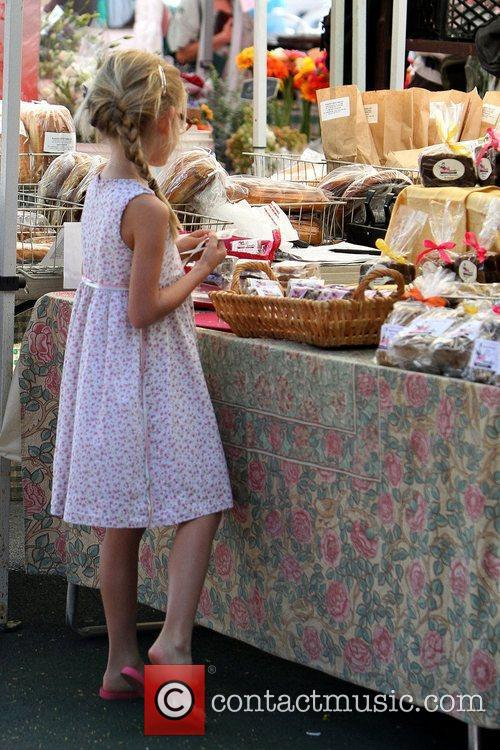 Violet Affleck picking out baked goods at a...