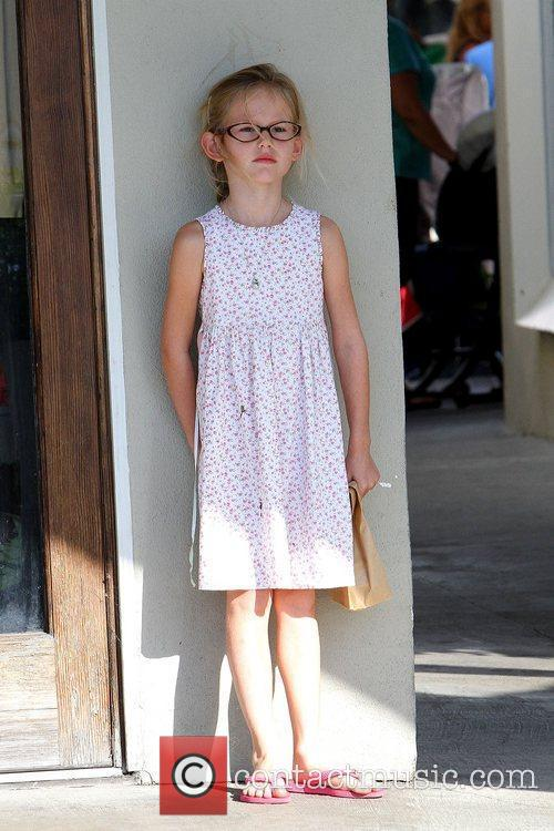 Violet Affleck up against a wall at a...