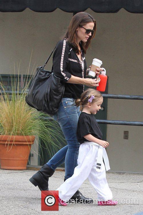 Jennifer Garner and husband Ben Affleck collect their...