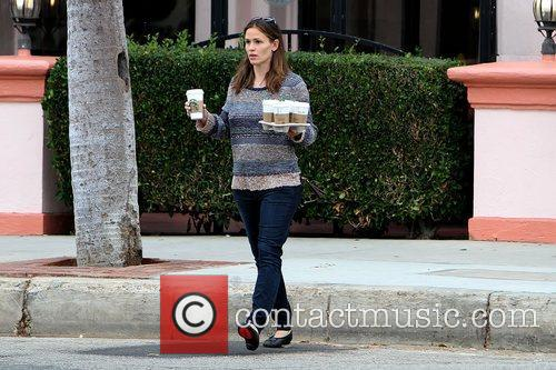 Jennifer Garner has her hands full while out...