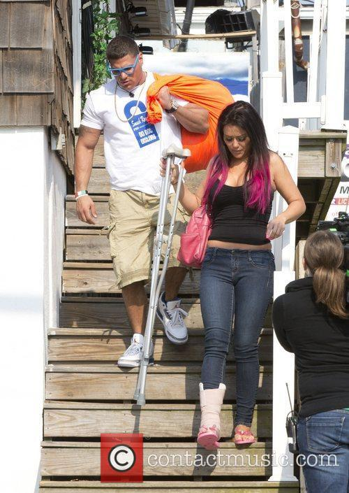 As she hobbles on her crutches as she...