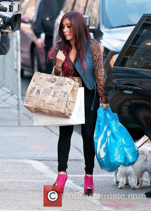 Nicole Polizzi out and about in the City....