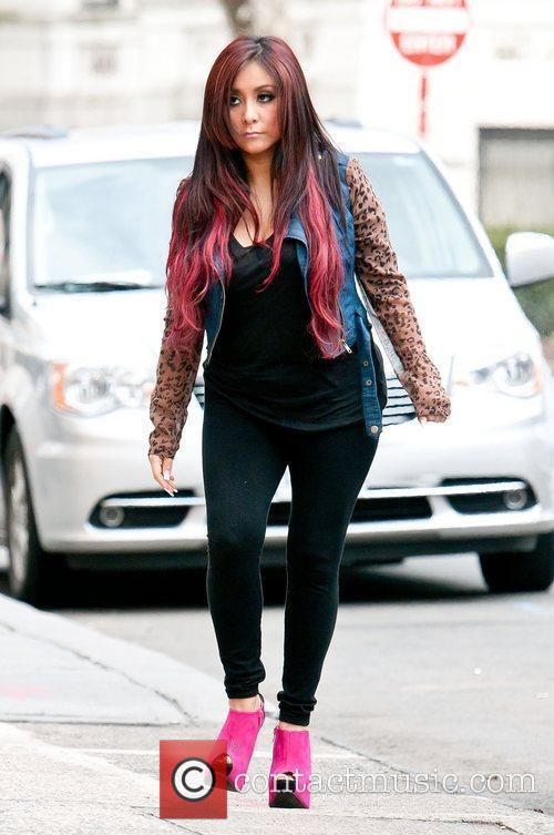 Nicole Polizzi out and about in the City.