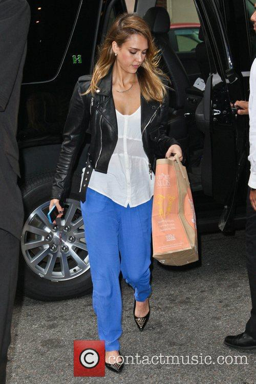 Arriving back at her hotel after shopping at...