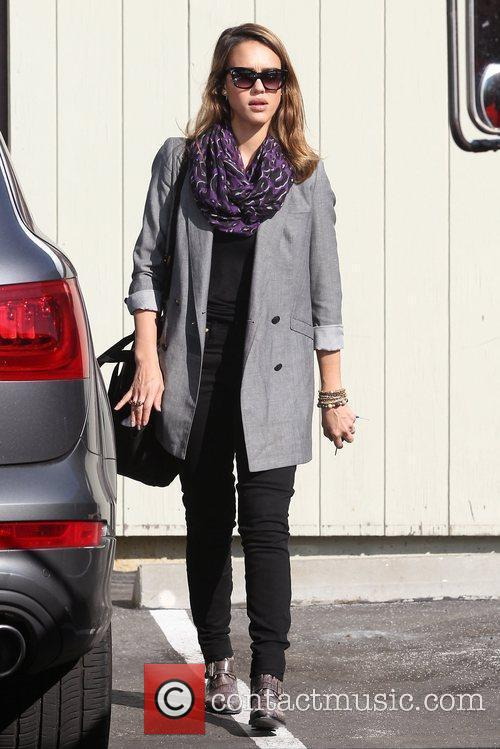 Jessica Alba arrives at an office building in...