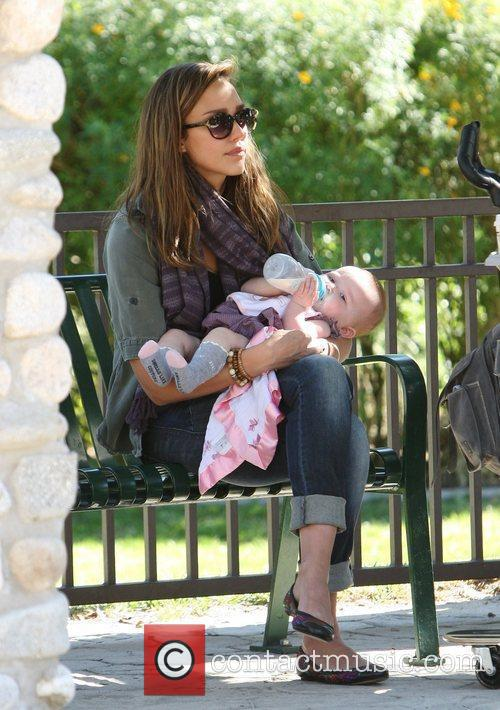 Jessica Alba sits on a bench with Haven...