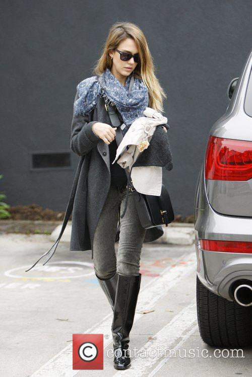 Jessica Alba returns to her car with her...