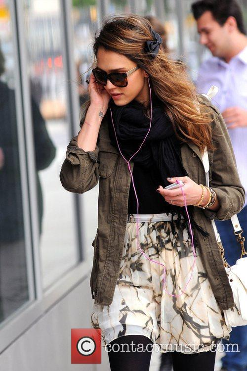 Jessica Alba out and about in Manhattan listening...