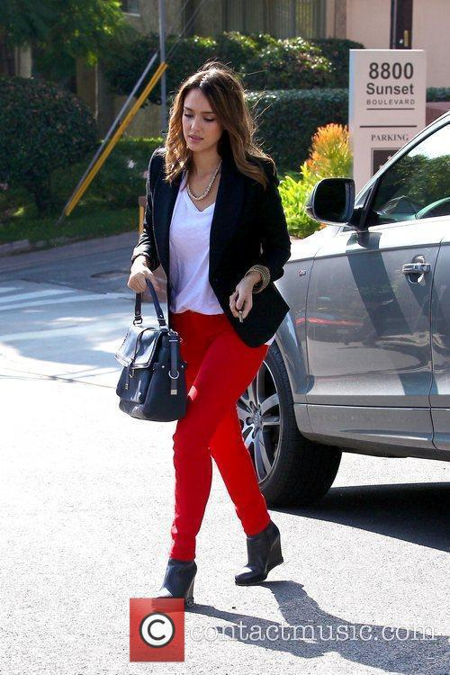 jessica alba wearing red pants as she 5761943