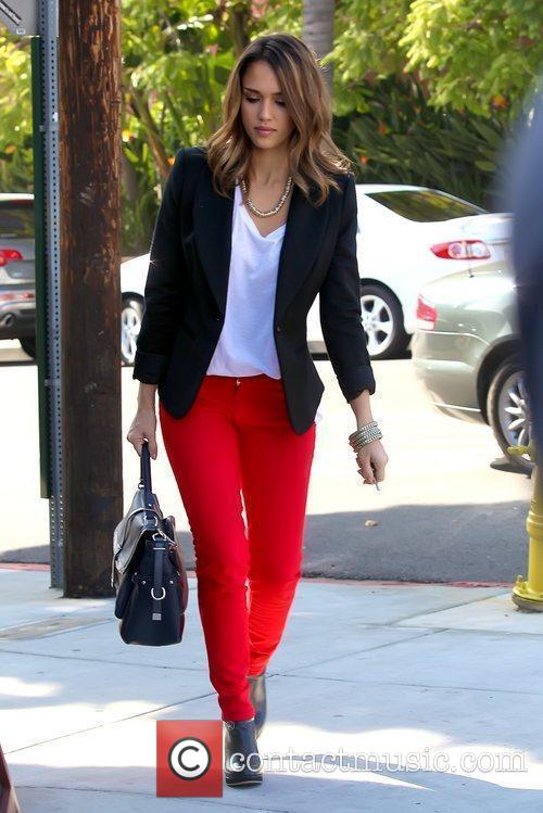 Wearing red pants as she goes to get...