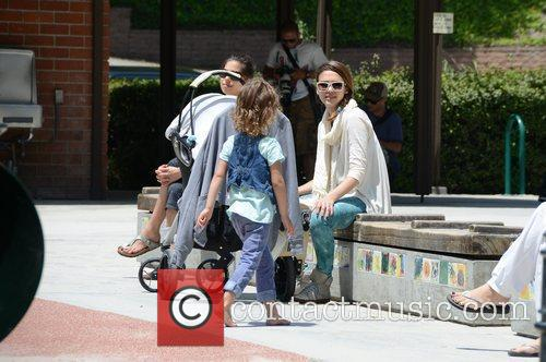 Jessica Alba takes her daughters to a park...