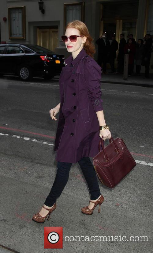 Jessica Chastain wears a purple trench coat outside...