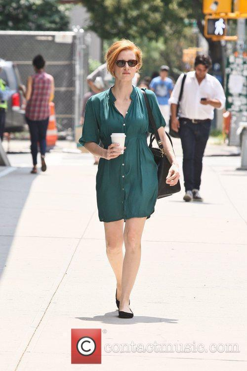 Jessica Chastain wearing a green dress on the...