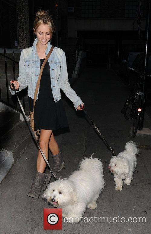 Walking her dogs in Soho