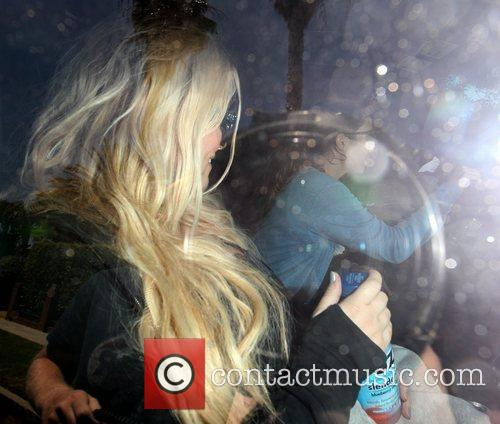 Is photographed in her car as she leaves...