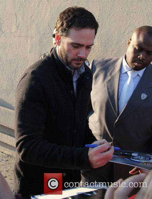 Signs autographs for fans outside the 'Jimmy Kimmel...