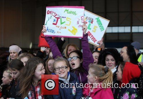 Fans JLS arrive at Liverpool's John Lennon Airport...
