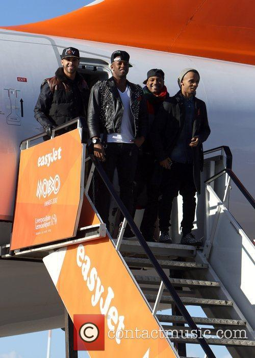 Arrive at Liverpool's John Lennon Airport onboard an...